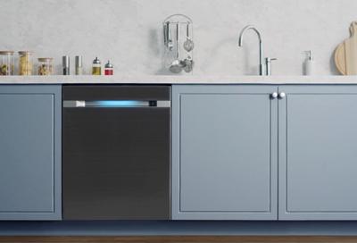 A Samsung dishwasher with the blue light illuminated